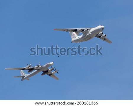 Moscow - May 7th, 2015: Tu-95MC planes and Il-78 flying one behind the other on a background of blue sky with clouds May 7, 2015, Moscow, Russia