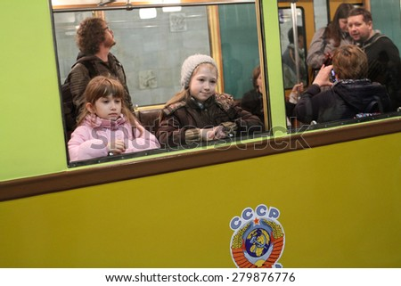 MOSCOW - MAY 5, 2015: Unidentified children look out the window at the exhibition of retro-cars dedicated to the 80th anniversary of the Moscow Metro. Public-event - stock photo