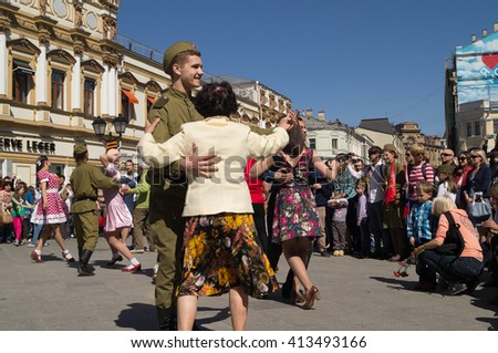 MOSCOW - MAY 09, 2014. Victory Day celebration: People dance war years dances  on Tverskaya  Square in Moscow.