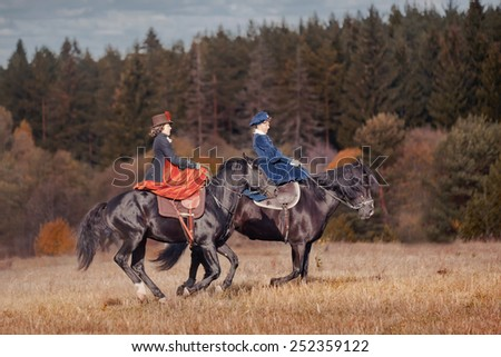 """MOSCOW, MOZHAYSK - CTOBER 10, 2014: Historical reconstruction of famous russian hounds hunting by horse club """"Avanpost"""" in Mozhaisk, Russia. 4 october 2014 - stock photo"""