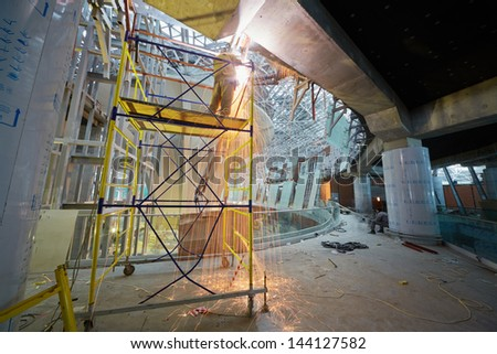 MOSCOW - NOV 29: Welding works on second floor at construction of terminal at Domodedovo Airport, November 29, 2012, Moscow, Russia. Terminal A has area of 96 thousand sq.m. - stock photo