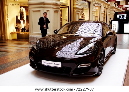 MOSCOW - NOVEMBER 14: Exposition of the Porsche Panamera in the GUM commercial center on November 14, 2011 in Moscow - stock photo