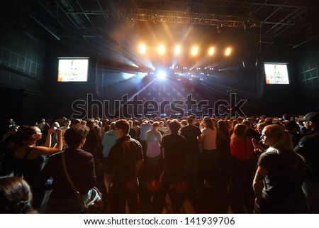 MOSCOW - OCT 12: Fans are waiting for rock band performances Night Snipers on stage of Stadium Live on October 12, 2012 in Moscow, Russia.  Night Snipers group performs at a concert of DAUGHTRY group. - stock photo