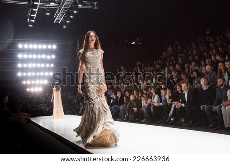 MOSCOW - OCTOBER 25: A model displays a creation by designer Tony Ward during Mercedes-Benz Fashion Week Russia on October 25, 2014 in Moscow, Russia. - stock photo