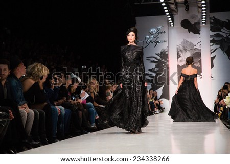 MOSCOW - OCTOBER 26: A model displays a creation by Russian designer Igor Gulyaev during Mercedes-Benz Fashion Week Russia on October 26, 2014 in Moscow, Russia. - stock photo