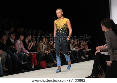 MOSCOW - OCTOBER 24: A model walks runway at the Viva Vox Collection for Spring/ Summer 2012 during Volvo Fashion Week on October 24, 2011 in Moscow, Russia