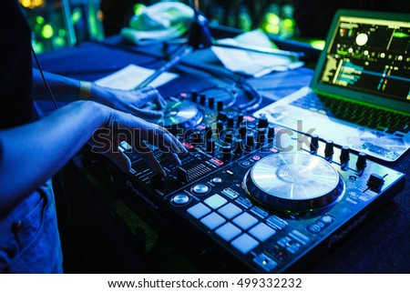MOSCOW - 14 OCTOBER,2016: Big concert.Focus on hands of girl DJ Katos playing music and scratching tracks on professional dj midi controller.Modern disc jockey equipment for concerts or house party