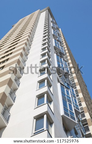MOSCOW - OCTOBER 7: Bottom view of building of residential complex Elk Island on October 7, 2011 in Moscow, Russia. Complex includes 1334 apartments of 40-143 square meters. - stock photo