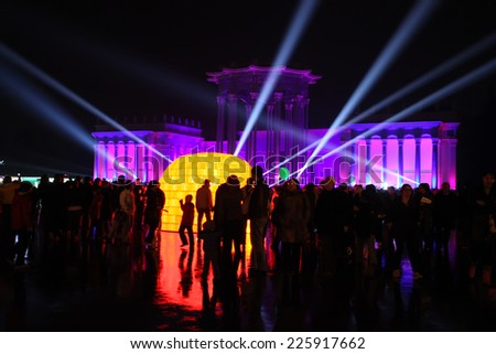 MOSCOW - OCTOBER 12: Illumination of the building at an exhibition (VDNH) during the International festival Circle of Light on october 12, 2014 in Moscow, Russia.  - stock photo