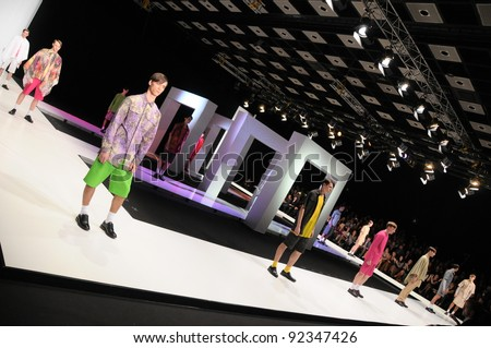 MOSCOW - OCTOBER 21: Male models walking runway at the Leonid Alexeev Collection for Spring/ Summer 2012 during Mercedes-Benz Fashion Week on October 21, 2011 in Moscow, Russia - stock photo