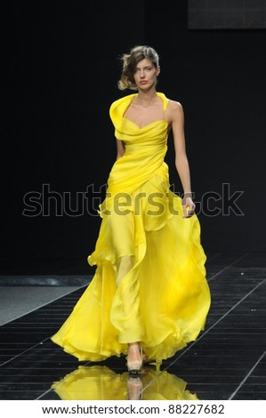 MOSCOW - OCTOBER 28: Model walks the runway at the Natalia Kolikhalova Collection for Spring/ Summer 2012 during Volvo Fashion Week on October 28, 2011 in Moscow, Russia - stock photo