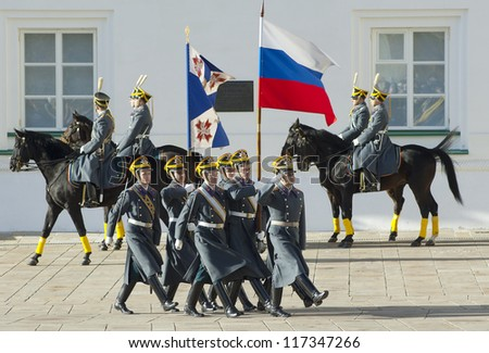 MOSCOW - OCTOBER 27: Unidentified guards of President Putin squad marching with flags on parade of change on October 27, 2012, in Moscow, Russia - stock photo