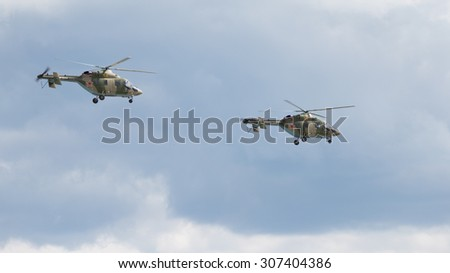 Moscow Region - June 17, 2015: Two military helicopters Ansat-U flying against the sky on demonstrations at air shows in Kubinka June 17, 2015 Moscow region, Russia