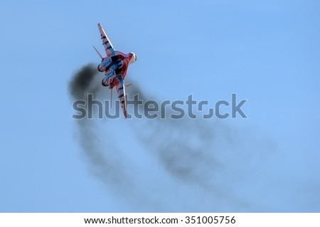 "Moscow region, Russia - April 19, 2013: Russian fighter Mikoyan-Gurevich MiG-29 of an aerobatic demonstration team of the Russian Air Force ""Strizhi"" ( The Swifts ) in flight."