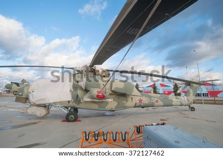 "MOSCOW REGION, RUSSIA - DECEMBER 8, 2015 : Shrouded Russian attack helicopter MI-28 ""Night hunter"" in the Parking lot in the new Park Patriot"