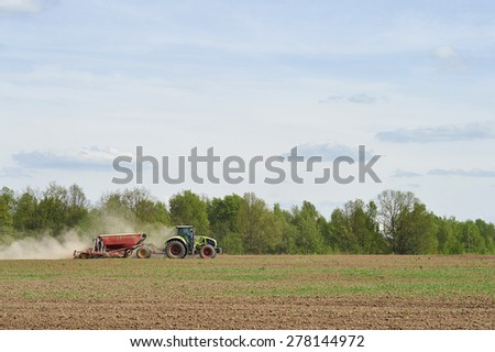 Moscow region, Russia - May 14: Planting tractor trailed planter in the field near Moscow May 14, 2015
