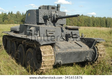 MOSCOW REGION, RUSSIA - SEPTEMBER 12, 2003 : Old Czechoslovak tank LT-38 in German painting at the landfill in Kubinka