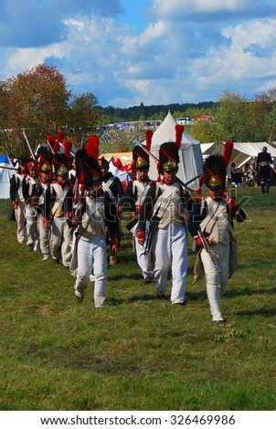 MOSCOW REGION - SEPTEMBER 07, 2014: Reenactors dressed as Napoleonic war soldiers participate in Borodino battle historical reenactment.