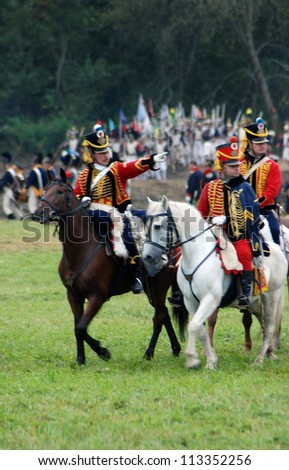 MOSCOW REGION - SEPTEMBER 02: Unknown soldiers riding horses at Borodino historical reenactment battle at its 200 anniversary. Taken on September 02, 2012 in Borodino, Moscow Region, Russia.