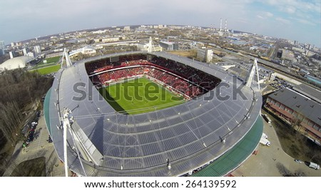 MOSCOW, RUSSIA - APR 28, 2014: People watch game in Locomotive sports stadium at evening. Aerial view
