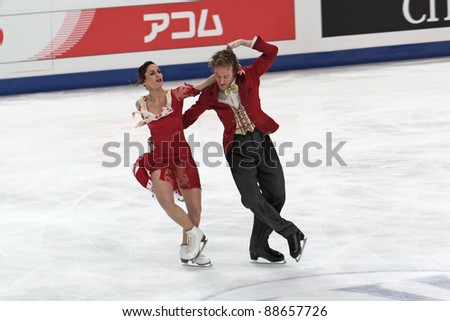 "MOSCOW, RUSSIA - APR 30: World championship on figure skating 2011. Fabian Bourzat and Nathalie Pechalat in pair ice dance. Palace of sports ""Megasport"" on April 30, 2011 in Moscow. - stock photo"