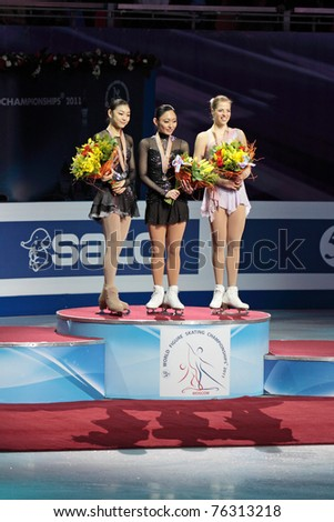MOSCOW, RUSSIA - APR 30: World championship on figure skating 2011. Rewarding of winners in single ladies free figure skating. Yuna Kim,  Miki Ando and Carolina Kostner on April 30, 2011 in Moscow. - stock photo