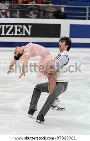 "MOSCOW, RUSSIA - APR 30: World championship on figure skating 2011. Xintong Huang and Xun Zheng in pair ice dance. Palace of sports ""Megasport"" on April 30, 2011 in Moscow. - stock photo"