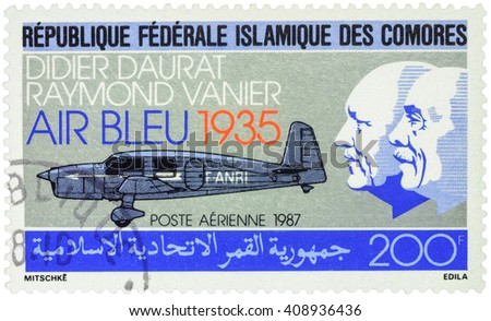 "MOSCOW, RUSSIA - APRIL 11, 2016: A stamp printed in Comoros shows old airplane and portraits of Didier Daurat and Raymond Vanier, ""Air Bleu"" airline company, series ""Airmail - Aviation"", circa 1987 - stock photo"