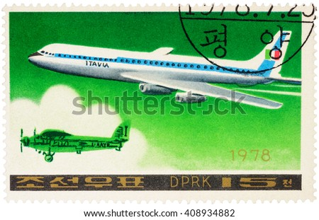 "MOSCOW, RUSSIA - APRIL 10, 2016: A stamp printed in DPRK (North Korea) shows American passenger aircraft Douglas DC-8-63 and old airplane, series ""Airplanes"", circa 1978 - stock photo"