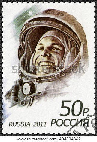 MOSCOW, RUSSIA - APRIL 12, 2011: A stamp printed in Russia shows first man in space, Yuri Alekseyevich Gagarin (1934-1968), the 50th anniversary of the first human spaceflight - stock photo