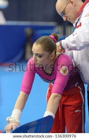 MOSCOW, RUSSIA - APRIL 20: Aliya Mustafina, Russia prepares to exercise on uneven bars in finals of 5th European Championships in Artistic Gymnastics in Moscow, Russia on April 20, 2013