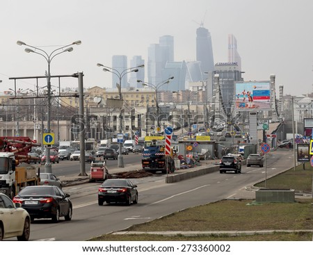 MOSCOW, RUSSIA - APRIL 6: bridge Krymsky and modern skyscrapers of  Moscow City - the biggest business center in capital of Russia on April 6, 2015. Offices of different companies are located there. - stock photo