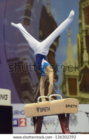 MOSCOW, RUSSIA - APRIL 20: Harutyum Merdinyan, Armenia performs exercise on pommel horse in final of 5th European Championships in Artistic Gymnastics in Moscow, Russia on April 20, 2013 - stock photo