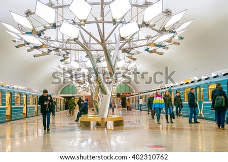 MOSCOW, RUSSIA - APRIL 04, 2016: Passengers in metro station Troparevo in Moscow, Russia. It was opened in December 08, 2014. - stock photo