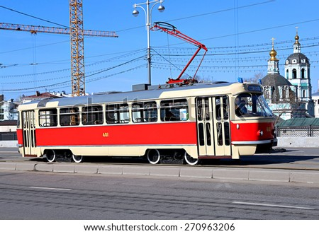 MOSCOW, RUSSIA - APRIL 11, 2015: Retro tram rides on Bolshoy Ustinsky Bridge in Moscow