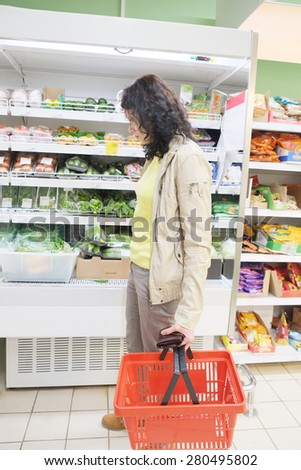 MOSCOW, RUSSIA  -  APRIL 09, 2015: Supermarket Pyaterochka with the most affordable prices. Russia's largest retailer. Woman shopping in supermarket - stock photo