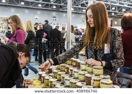 Moscow, Russia - April 16, 2016: The 3rd International exhibition Art & Craft Expo. The works of artists, craftsmen, artisans and talented craftsmen at the exhibition.Focus on jam jars - stock photo
