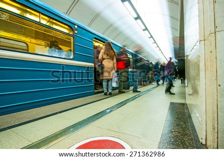 MOSCOW, RUSSIA - APRIL 17, 2015: Train and passengers  in subway station Mendeleevskaya in Moscow, Russia
