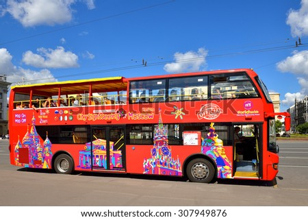 MOSCOW, RUSSIA - AUG 14, 2015: Bright red double-decker tour buses are prowling Moscow's streets, giving visitors great view of city centre. Hop On-Hop Off tour offers excursions in eight languages - stock photo