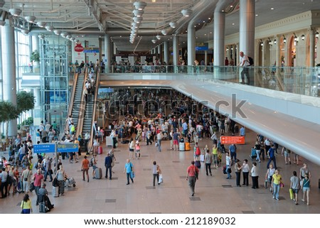 MOSCOW, RUSSIA - AUG 04, 2013: Domodedovo international airport. Significant passenger traffic in the midst of the holiday season - stock photo