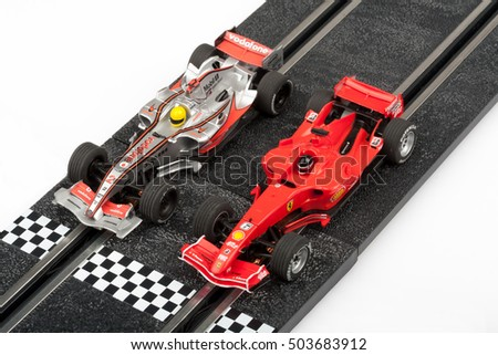 Moscow, Russia - Aug 14, 2010: Slot car racing track with formula one cars at start line.