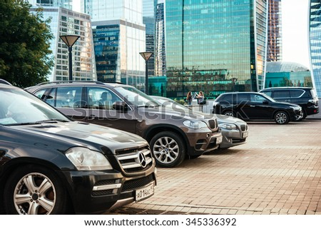 MOSCOW, RUSSIA - AUGUST 18, 2015: Car parking in front of skyscrapers of Moscow City international business centre in Moscow, Russia. - stock photo