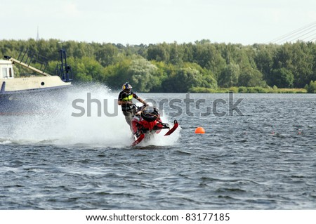 "MOSCOW, RUSSIA- AUGUST 07: Daniel Bodin cross the river on snowmobile  ""Red Bull Flugtag 2011"" August 7, 2011 in Moscow, Russia"