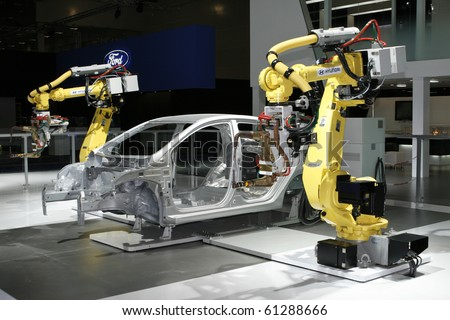MOSCOW, RUSSIA - AUGUST 27: Hyundai Industrial robots for welding & handling presented at the Moscow International Autosalon on August 27, 2010 in Moscow. - stock photo