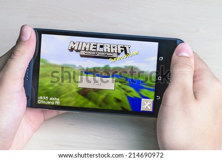 Moscow, Russia - August 26, 2014: Minecraft computer game in the genre with elements of survival sandbox and open world for smartphone htc. Developed by Swedish programmer Markus Persson  - stock photo