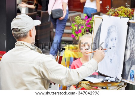 MOSCOW, RUSSIA - AUGUST 26, 2015: The artist working on picture on Aug, 26 20135, Moscow, Russia.