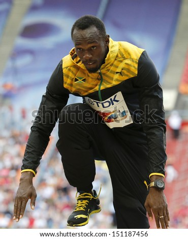 MOSCOW, RUSSIA - AUGUST 17: Usain Bolt celebrates his win at the World Athletics Championships on August 17, 2013 in Moscow - stock photo