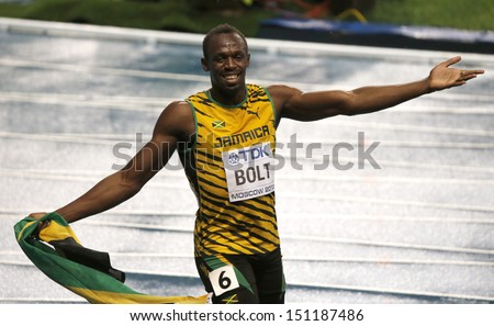 MOSCOW, RUSSIA - AUGUST 11: Usain Bolt celebrates his win at the World Athletics Championships on August 11, 2013 in Moscow - stock photo