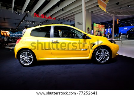 MOSCOW, RUSSIA - AUGUST 25:  Yellow car Renault Clio on display at Moscow International exhibition InterAuto on August 25, 2010 in Moscow, Russia. - stock photo