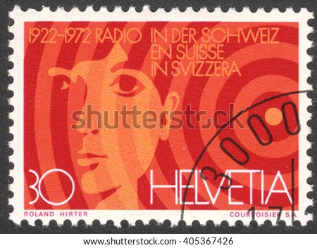 MOSCOW, RUSSIA - CIRCA APRIL, 2016: a post stamp printed in SWITZERLAND, devoted to the 50th anniversary of Radio Switzerland, sirca 1972 - stock photo